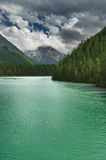 Turquoise lake. Landscape with mountains, forest and beautiful turquoise lake Stock Photography