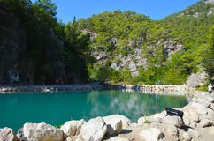 Turquoise lake on the background of mountains in the summer sunny day, Goynuk canyon near Kemer, Turkey stock photo