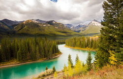 Turquoise lake in Banff National Park Alberta Canada in the summer. Summer landscape next to rail tracks in Banff National Park Alberta Canada on a cloudy day Royalty Free Stock Photography