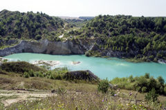 Turquoise lake. At the bottom of the Cretaceous career Stock Images
