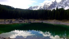 Turquoise lake Carezza in the Alps at sunrise, Italy. Europe stock footage