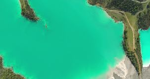 Turquoise Lake and Forest Aerial Footage stock footage