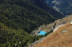 Turquoise lake Mosjesee and colorful larch forest royalty free stock photos