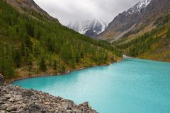 Turquoise lake and mountains. stock photo