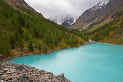 Turquoise lake and mountains. Stock Photo