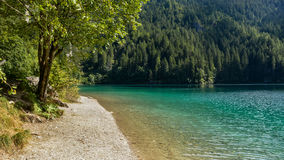 Turquoise lake in the mountains Stock Photo