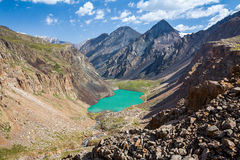 Turquoise lake in mountains of Tien Shan Royalty Free Stock Image