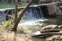 Lake Water Cascade. Turquoise lake water cascading over travertine rocks Royalty Free Stock Image