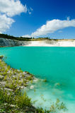 A turquoise lake with white cliff Stock Photo