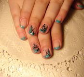 Turquoise manicure with a pattern. stock photos