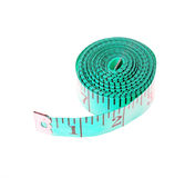 Turquoise measuring tape rolled up Stock Image