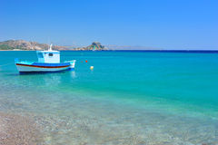 Turquoise Mediterranean sea. And a small boat Royalty Free Stock Photo