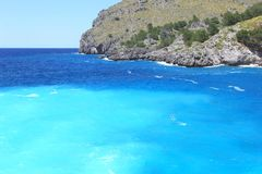 Turquoise Mediterranean sea bay rocks, Majorca Royalty Free Stock Images