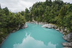 Hokitika Gorge turquoise glacier water. Turquoise milky glacier water in Hokitika gorge New Zealand with green forest jungle royalty free stock photos