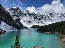 Turquoise Moraine lake in Banff National Park. Majestic snow peaks with the stunning glacier snow melt, makes Moraine lake one of the most scenic place on earth Royalty Free Stock Image
