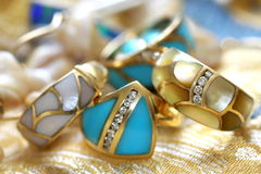 Turquoise and mother of perl rings Royalty Free Stock Images