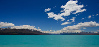 Turquoise Mountain Lake. Beautiful mountain turquoise lake, deep blue sky and snow peaks. Mount Cook National Park, New Zealand Royalty Free Stock Images