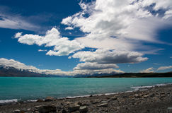 Turquoise Mountain Lake. Beautiful mountain turquoise lake, deep blue sky and snow peaks. Mount Cook National Park, New Zealand Royalty Free Stock Image