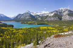 Turquoise mountain lake in fall Stock Images