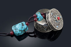 Turquoise Necklace and jewelry box. Turquoise Necklace and handmade silver jewelry box, made in Tibet Stock Image