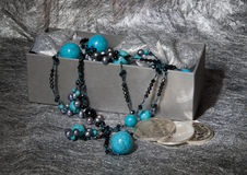 Turquoise  Necklace on Silver Background Stock Image
