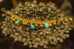 Turquoise necklace on the stones Royalty Free Stock Photo