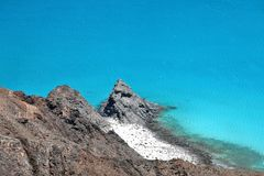 Turquoise ocean, beautiful cliff and white sand beach Stock Photo