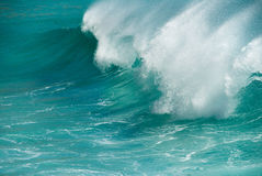 Turquoise ocean wave breaking Stock Photos