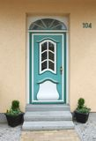 Turquoise old wooden door, with glass window and skylight Stock Images