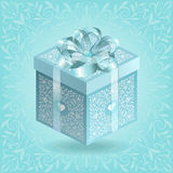Turquoise ornate gift box with silk ribbon and bow. For design Stock Photos