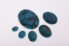 Turquoise. Oval turquoise cabochons of different sizes Royalty Free Stock Photo