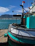 Boat moored in Cape Town, South Africa royalty free stock images