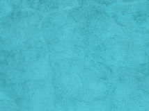 Turquoise painted plaster wall as a background Royalty Free Stock Photo