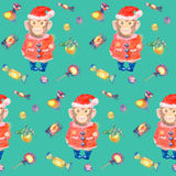 Turquoise pattern with sweets and a smiling monkey in a New Years suit. Pattern with sweets and a smiling monkey in a New Years suit and Christmas hat on a Stock Image