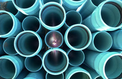 Turquoise Pipes 5. Water-Sewer Pipes Stacked and Ready For Construction Stock Image