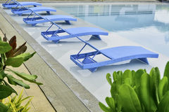 Turquoise Pool Benches Royalty Free Stock Images