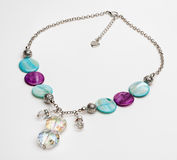 Turquoise and purple necklace with gemstones. On isolated background Stock Photos
