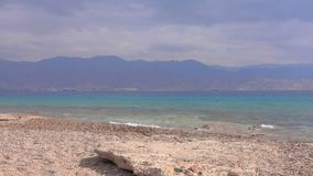 Turquoise of red sea and lilac mountains. On the background stock video footage