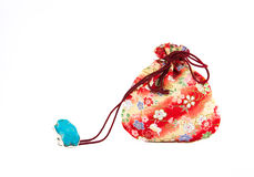 Turquoise  ring and Small red bag Stock Images