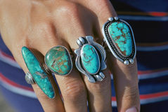 Turquoise rings. Pueblo Indian and Navajo Indian silver and turquoise jewelry on the hand of a visitor to the historic plaza in downtown Santa Fe, New Mexico Stock Images