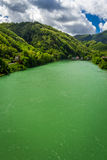 Turquoise river in the background of Alps Royalty Free Stock Images