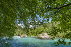Turquoise river with boulders Stock Photos