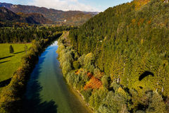 Turquoise river flowing through forested landscape Royalty Free Stock Photos
