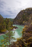 Turquoise river flowing between the rocks royalty free stock image