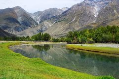 Turquoise river and mountains. Altay Stock Photo