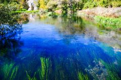 Turquoise river. Pittoresque  view   of   turquoise river part of the  meander  of Panega river, Bulgaria in a sunny autumn  day Stock Photo