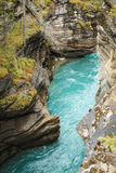 Turquoise river. Turquoise water flowing through a carved river valley, Canadian Rockies Stock Photo
