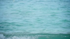 Turquoise rolling wave, slow motion. Turquoise waves rolled on the beach coral sand, Koh Miang Island, Similan, slow motion Best use for relaxing video stock footage