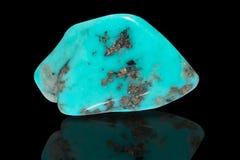 Turquoise. Sample of a beautiful Turquoise tumbled stone specimen isolated on black background stock image