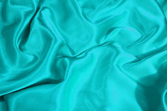 Turquoise satin Stock Images